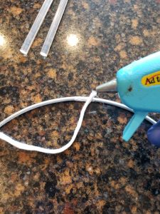 attaching cord to hoop with glue gun