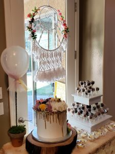 Desert Table decorated with Macreme Dream-Catcher, drip cake with florals, cookies and cake pops